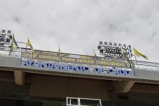 """Unidos Para Seguir Creciendo, eslogan de la FPC, en el anillo superior de """"Carranza"""""""